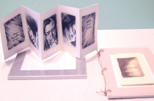 The interactive artist book (one opened, one encased) by Matina Marki Tillman described here.