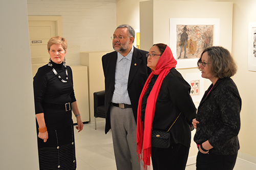 Anne Gordon, Executive Director of Vula Amehlo Art Development (far left), provides a tour of the exhibition to South African Ambassador to the United States Ebrahim Rasool (second from left); to Ambassador Rasool's wife Roseida Shabodien (third from left); and to Christine Mullen Kreamer, Deputy Director and Chief Curator of the Smithsonian National Museum of African Art (far right).