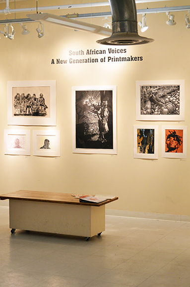 A view of the South African Voices exhibition marquee and some prints included in the show.