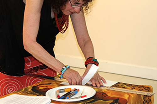 Marian Osher provides an artist's demonstration during the reception. Photo by Steve Raphael.